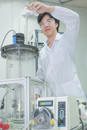 Asian scientist working in laboratory photo