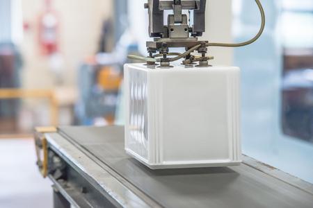 Industrial robot working in factory photo