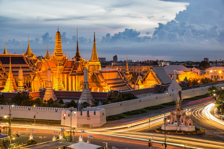 Grand palace at twilight with light from traffic in Bangkok, Thailand Stock Photo