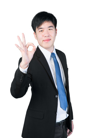 ok sign: ok hand sign gesture from asian businessman isolate on white background with clipping path