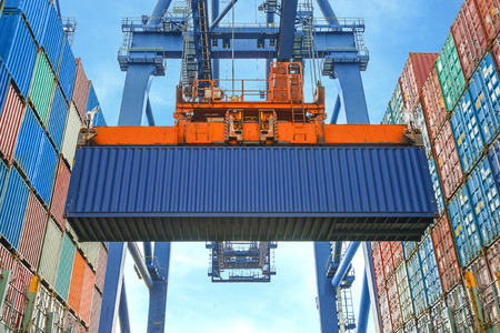 ship: Shore crane loading containers in freight ship