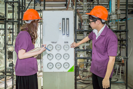 thai student: Chemical engineer student checking equipment in control room for training