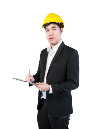 Asian engineer taking notes isolate on white background with clipping path photo