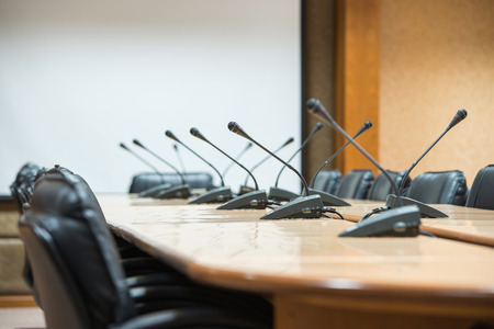 before a conference, the microphones in front of empty chairs. Stock Photo