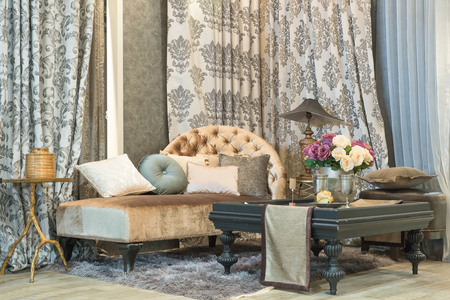 classic living room: living room with classic looking sofa, luxuryl curtains, lamp and glass table Editorial