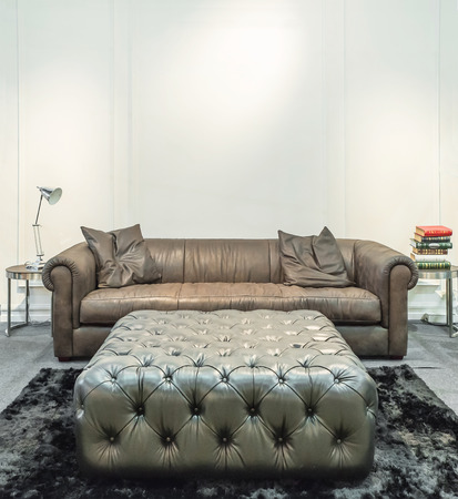 Spacious living room with huge sofa in a luxury house photo