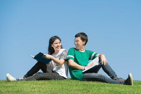 thai student: Couple of Asian students outdoors looking very happy