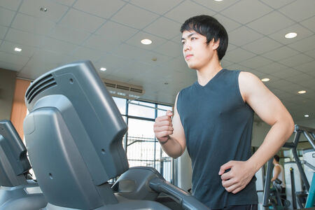 asian adults: young people running on treadmill in gym