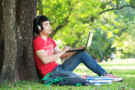 Portrait of student relaxing in the park. photo