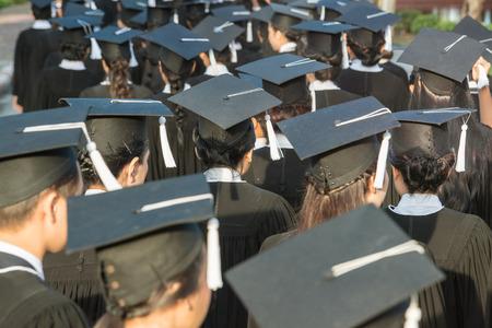 black cap: back of graduates during commencement