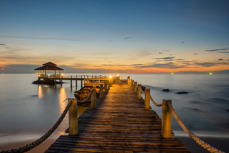 Landscape of Wooded bridge pier between sunset photo