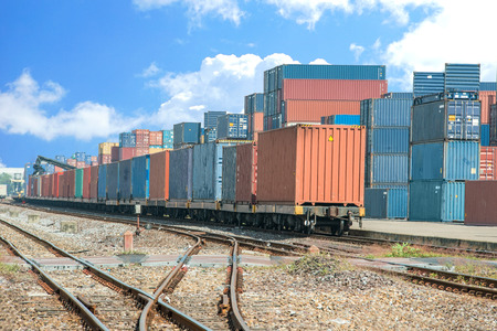 Cargo train platform with freight train container at depot Stockfoto
