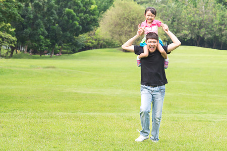 asian men: Asian family concept - Father Giving Daughter Piggyback Ride Stock Photo