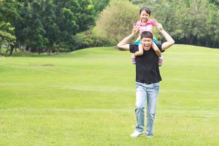 Asian family concept - Father Giving Daughter Piggyback Ride Stock Photo