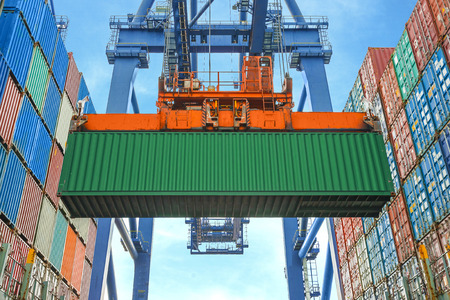 freight container: Shore crane loading containers in freight ship