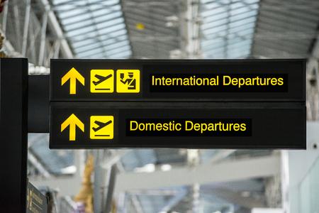 空港出発・到着情報板サイン 写真素材