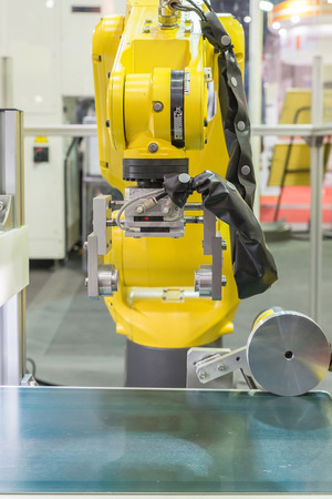 optical equipment: Automatic robot arm with optical sensor working in factory