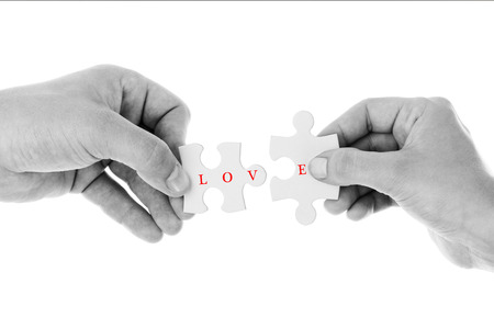 red puzzle piece: Love concept - Jigsaw of love in Black & White color Stock Photo