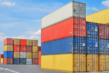 merchandize: Stacked cargo containers in storage area of freight sea port terminal