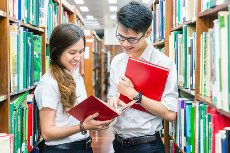 uniform student: Asian couple of students in uniform at library