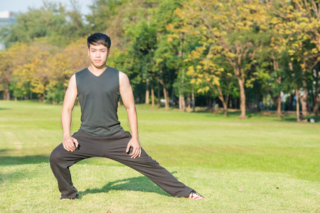 thai stretch: Asian fitness man stretching at the park - fitness concepts sports exercises.