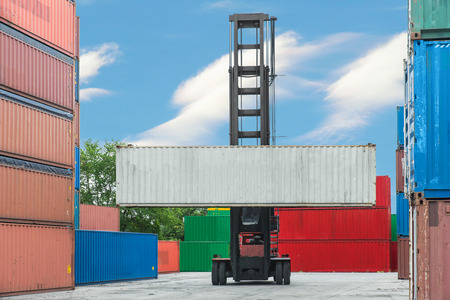 reach truck: Forklift handling container box loading to depot