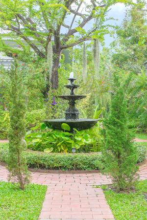 garden fountain: The Fountain in the green garden at home Stock Photo