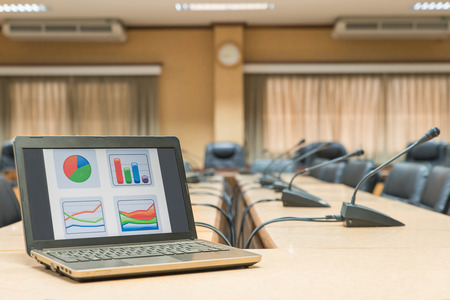 classroom training: Before a conference,Laptop in front of empty chairs at conference room Stock Photo