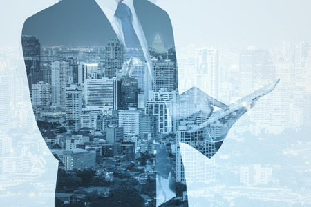 asia business: Double exposure of city and business man using digital tablet Stock Photo