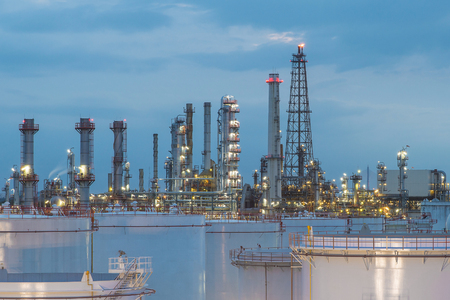 storage tanks: Oil refinery and storage tanks at twilight