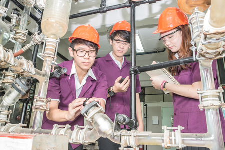 thai student: Engineer student turning pipeline pump for training in laboratory Stock Photo