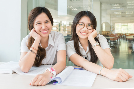 Two Asian students studying together at university Stock Photo