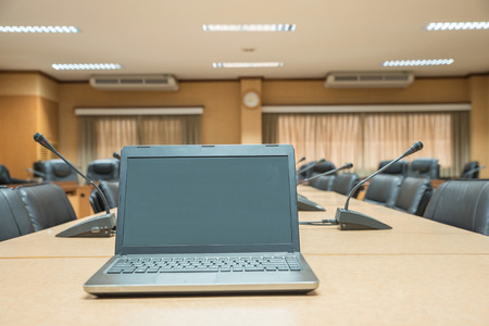 computer classroom: Before a conference,Laptop in front of empty chairs at conference room Stock Photo