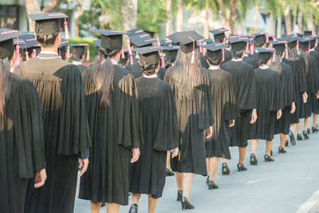 black graduate: back of graduates during commencement. Stock Photo