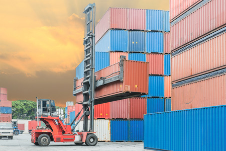 reach truck: Crane lifter handling container box loading to depot