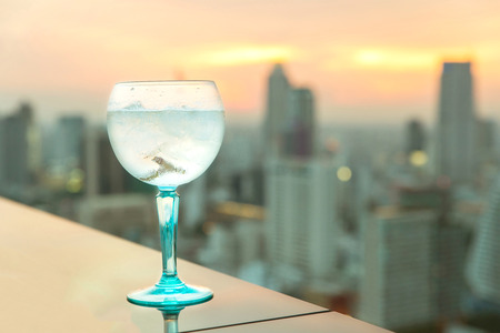 gin: Gin tonic cocktail on table in rooftop bar Stock Photo