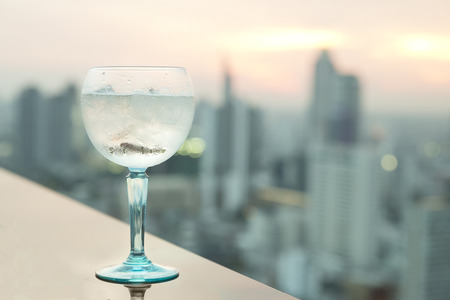 juice bar: Gin tonic cocktail on table in rooftop bar Stock Photo
