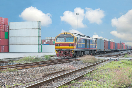 goods train: Cargo train platform with freight train container at depot Editorial