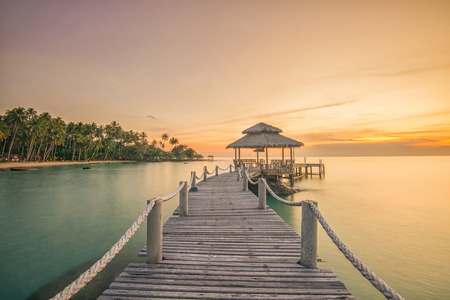 docks: Summer, Travel, Vacation and Holiday concept - Wooden pier between sunset in Phuket, Thailand
