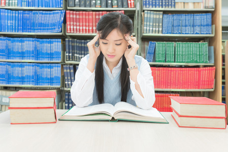 under pressure: Young asian student under mental pressure