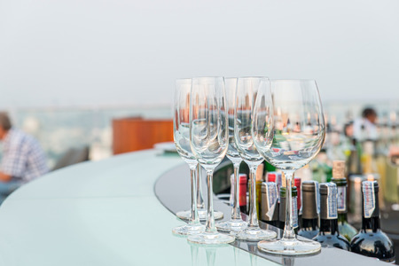 counter light: Many empty glass on counter at rooftop bar