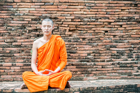 myanmar: Thai monk meditation at temple in Ayutthaya, Thailand Stock Photo