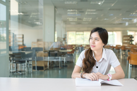 thinking: Asian student wondering or thinking about something