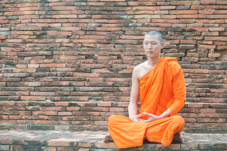 ayutthaya: Thai monk meditation at temple in Ayutthaya, Thailand Stock Photo