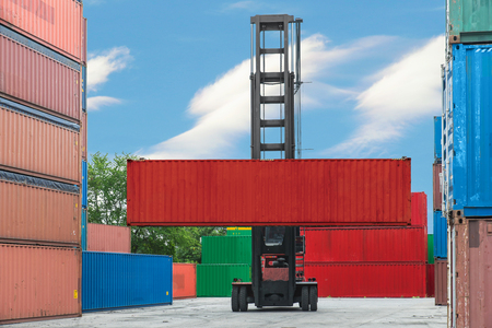 forklift: Forklift handling container box loading to depot