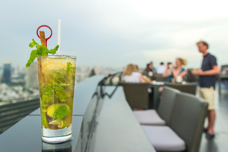 drinks on bar: Mojito cocktail on table in rooftop bar