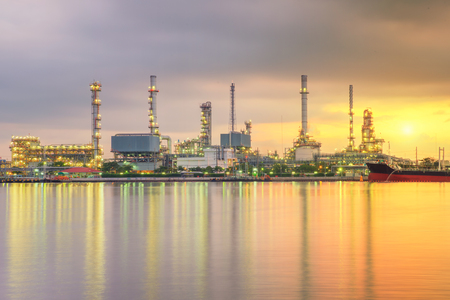 industry: Oil tank ship mooring in oil refinery industry at twilight time