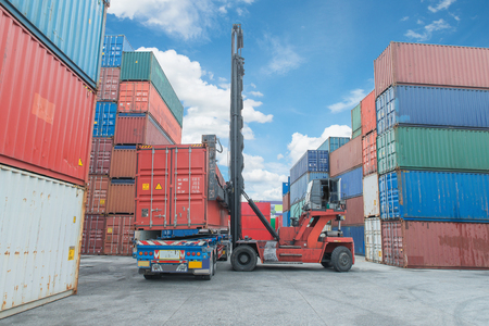 weight lifter: Crane lifter handling container box loading to truck