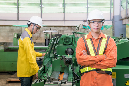 asian adult: Asian Mechanical Engineer working in factory