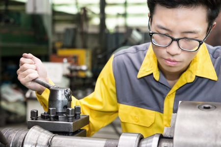 the factory: Mechanical Engineering control lathe machine in factory Stock Photo